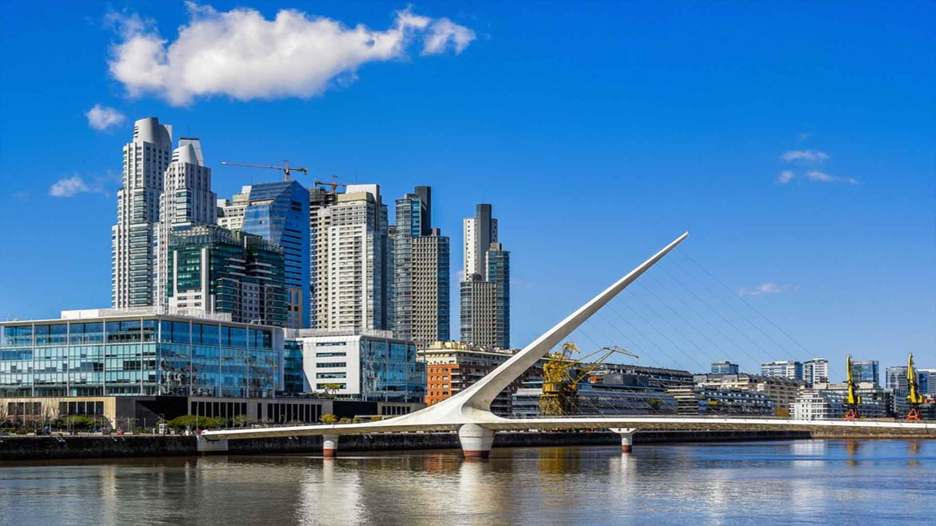 The Complete Buenos Aires Vacation Travel Guide Zen Tripstar Puerto Madero with the Puente de la Mujer Buenos Aires Argentina.