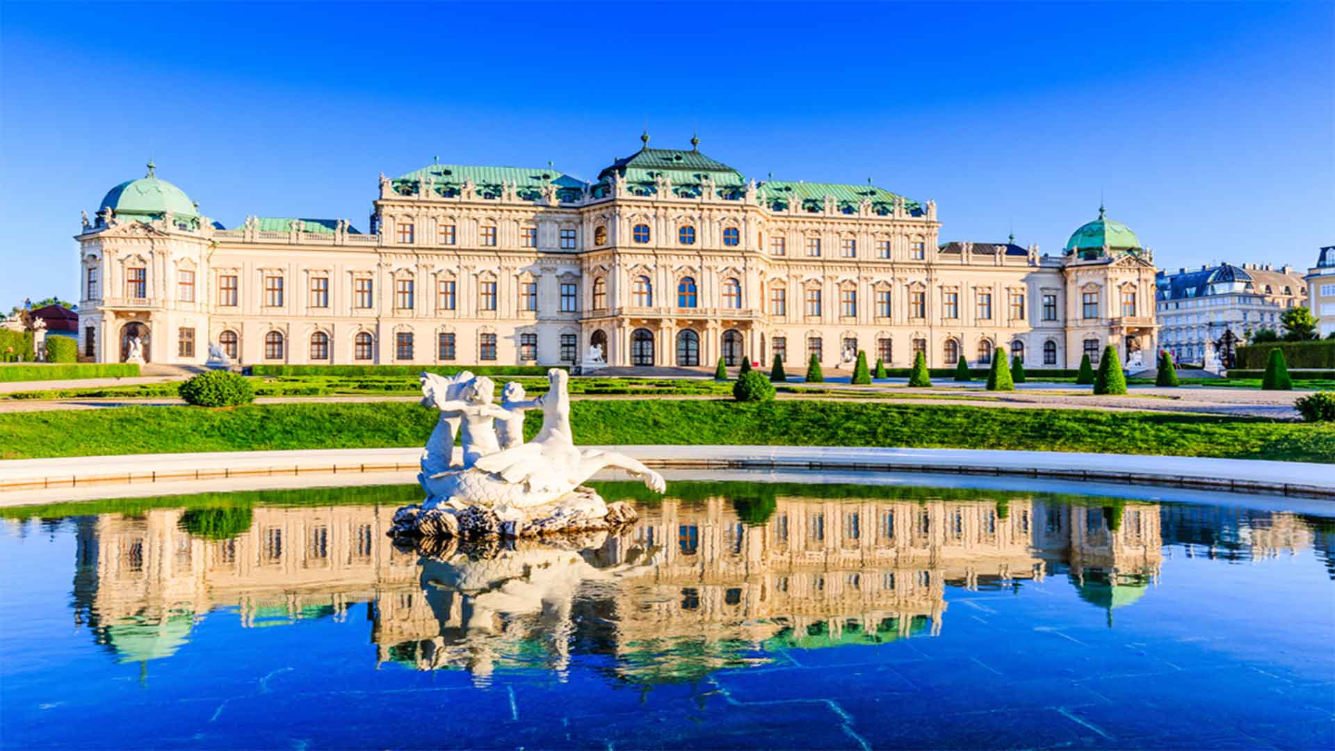The Complete Vienna Vacation Travel Guide Zen Tripstar Vienna Austria. Upper Belvedere Palace with reflection in the water fountain.